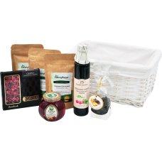 Zestaw herbat i słodkości w białym koszu prezentowym